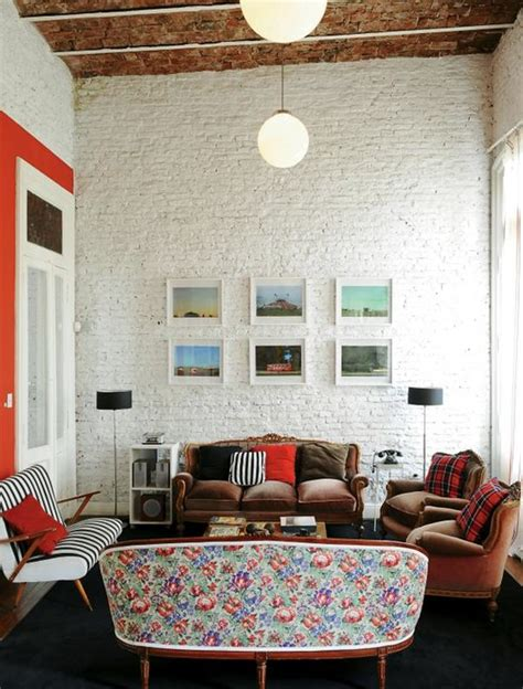 brick wall living room painting brick walls white an increasingly popular trend
