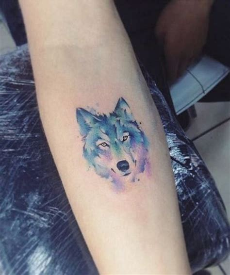 small wolf head tattoo looking watercolor wolf design on wrist