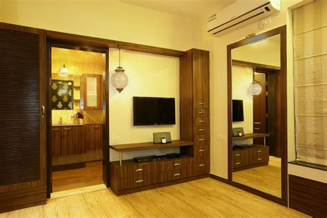 Bedroom Wardrobe Designs With Tv Unit by Navmiti Designs Perceive The New Dimensions