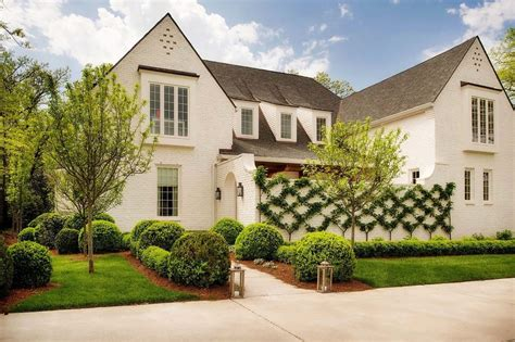 transitional home style charming english country house in nashville with a modern