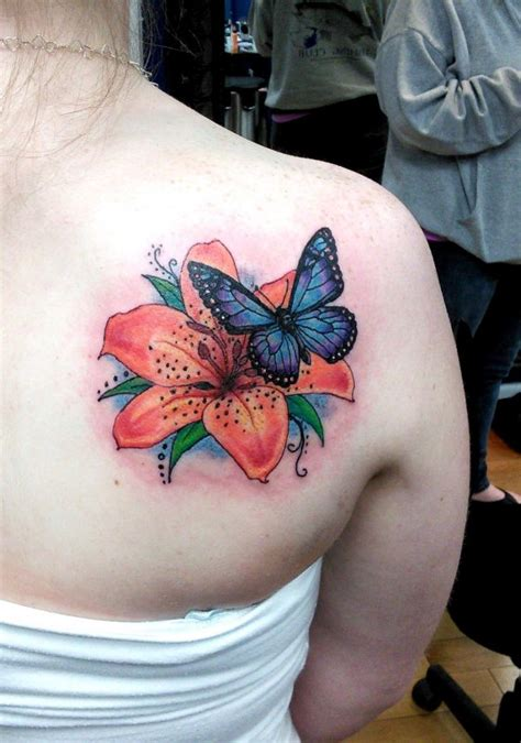 butterfly on a rose tattoo 55 butterfly flower tattoos