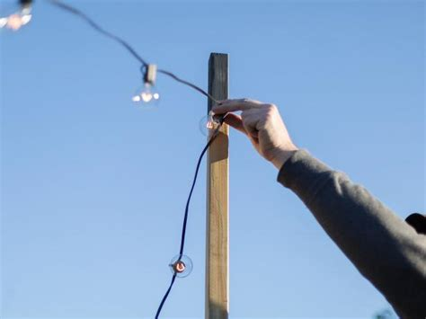 for lights how to hang outdoor string lights from diy posts hgtv