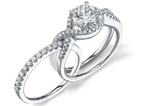 i love the idea of the wedding band and engagement ring fitting together or intertwining