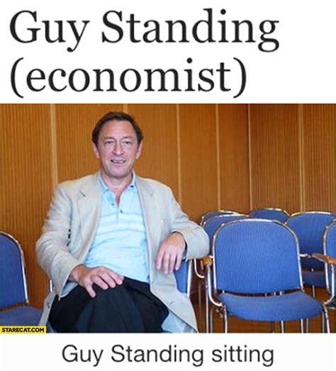 Guy standing economist sitting   StareCat.com