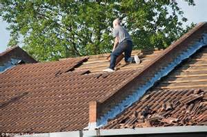 roofing a house hammer wielding man rips roof tiles off house during police stand off daily mail online