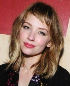 wavy lob with bangs 30 super chic medium hairstyles with bangs
