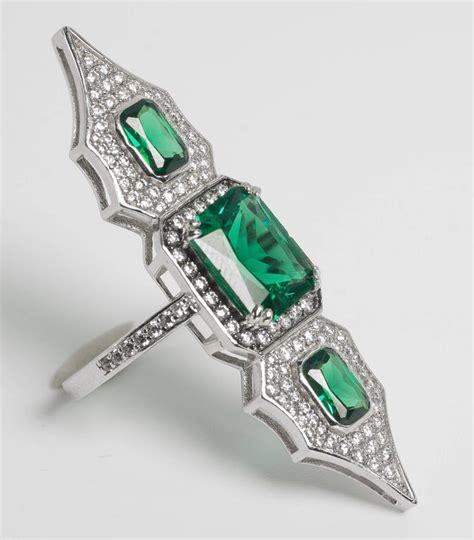 elegantly feminine faux emerald arabesque ring at