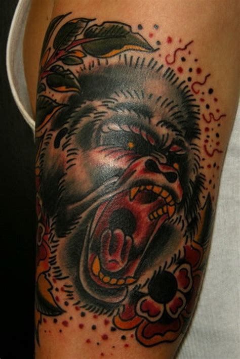 old school tattoo upper arm old school color ink gorilla with flowers tattoo on upper