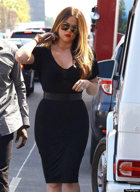 Khloe Kardashian Looks Smoking In Tight Black Skirt And