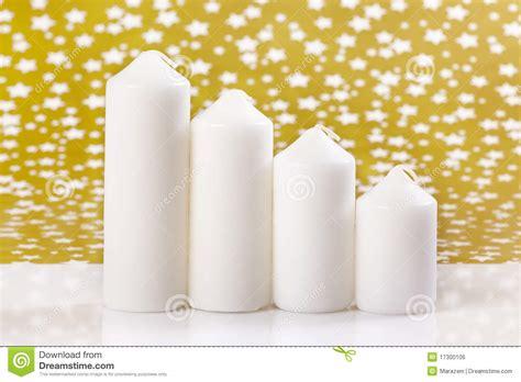 candele piccole quattro candele bianche fotografia stock immagine di