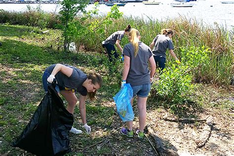 volunteers collect litter at white rock lake park every