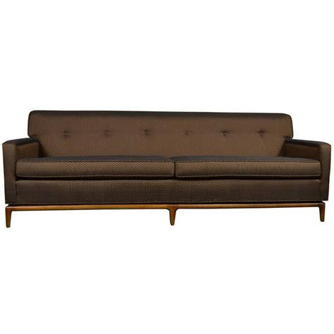 mid century modern tufted tight back tuxedo sofa on walnut
