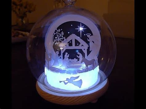 process of manufacturing snow globe an led lit snow globe nativity decoration