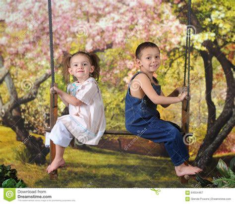 person swinging spring swinging preschoolers stock photo image 64554467