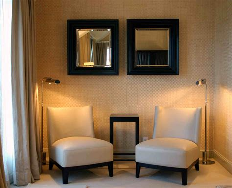 chairs to put in bedroom wondrous modern bedroom decors with double square wall mirror over two beige vinyl seater