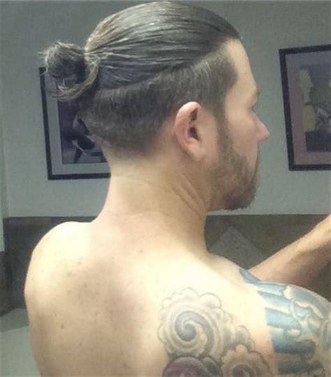 half shaved bun guy hair the man bun undercut and slicked back undercut man bun