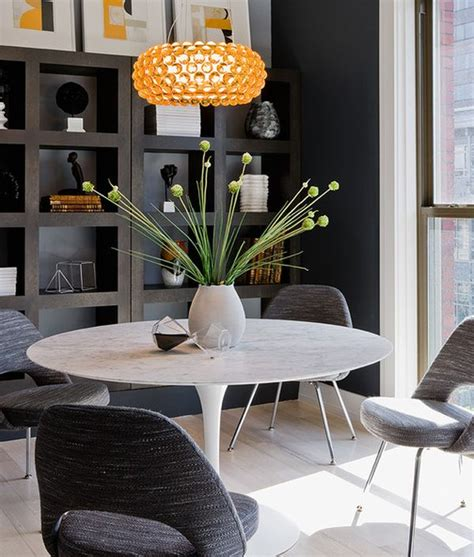 mixing modern chairs with antique table tulip chairs go saarinen tulip table a design classic perfect for