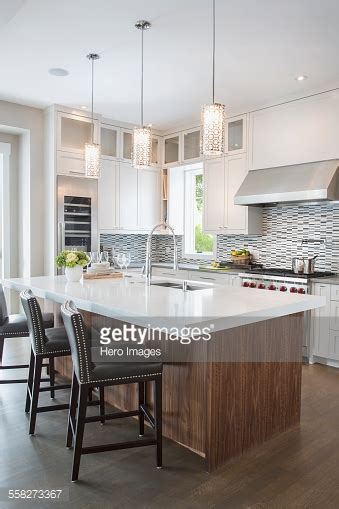 White Kitchen Island Lighting Pendant Lights Modern White Kitchen Island Stock Photo Getty Images