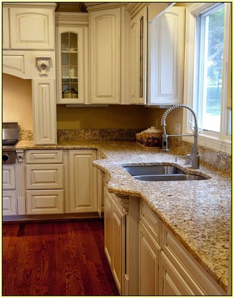 brown granite with white cabinets white kitchen cabinets with brown granite countertops home