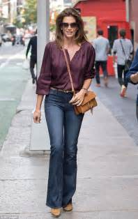 goes casual chic in sheer blouse and daily mail
