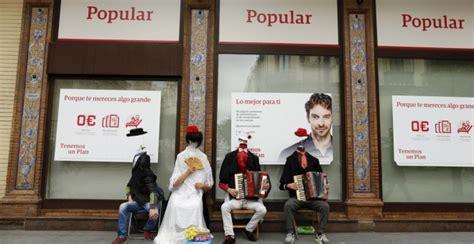 oficinas banco popular en sevilla los mercados ven a santander o a bankia como posibles