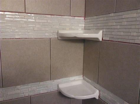 diy shower tiling installing floating corner shelves