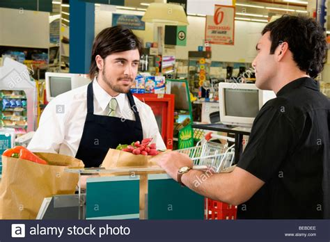 sales clerk selling products to a costumer in a