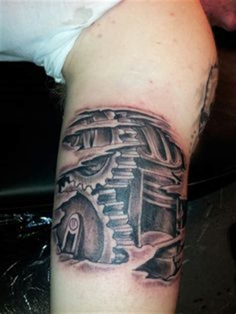 biomechanical tattoo denver biomechanical tattoo shock tattoo skin rip under skin