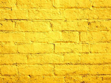 bright yellow wallpaper for walls yellow painted brick wall free stock photo public domain