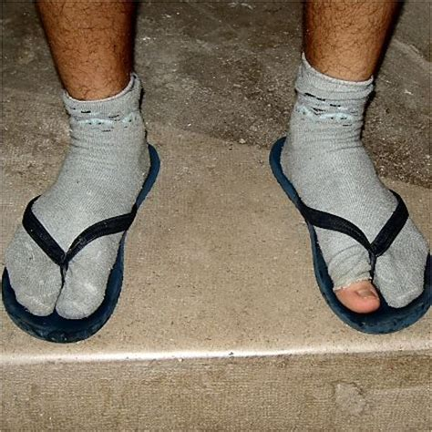 socks and sandals gross if your socks holes in them throw them away