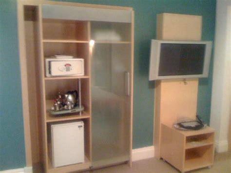 5018 television with closet and mini fridge safe tea and