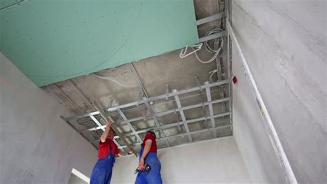 Metal Ceiling Installation by Workers Verify Accuracy Of Installation Frame For Hung