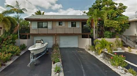 Key West Parking Garage by Just Listed Canal Front Home With Pool In Key West