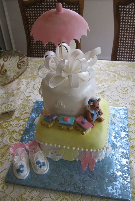 Baby Shower Cake With Baby On Top by Top View Of The Baby Shower Cake With Baby Shoes