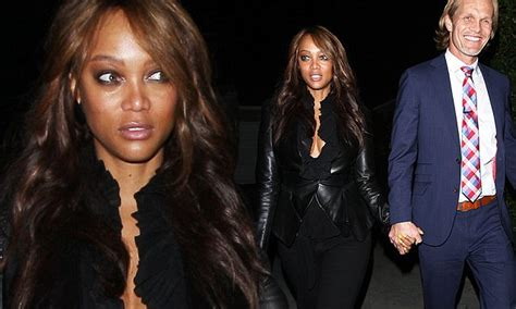 tyra banks flashes  cleavage   cut top  beau