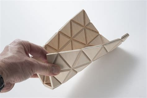 Flat Origami Designs - origami inspired flat pack wooden table pops into shape