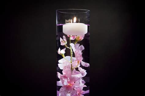 pink floral centerpiece with led lights and floating candles