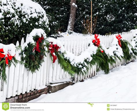 images of christmas garland on a fences wreath in snow stock image image of 36128687
