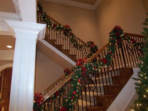 christmas lights for stair banisters christmas deck the halls with beautiful garland west