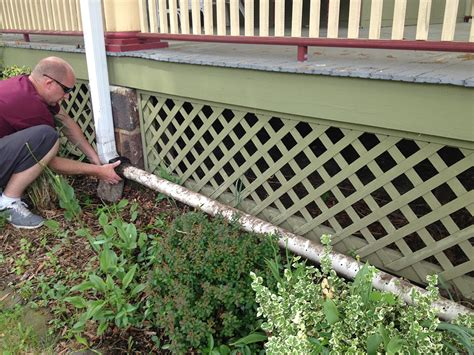 DIY Rain Gutter Watering System: Turn your gutter into a