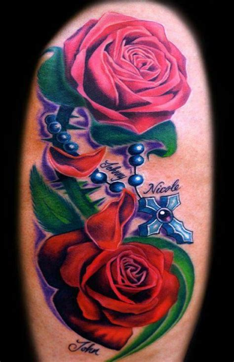 tattoos of roses and rosary beads and pink with blue cross rosary bead