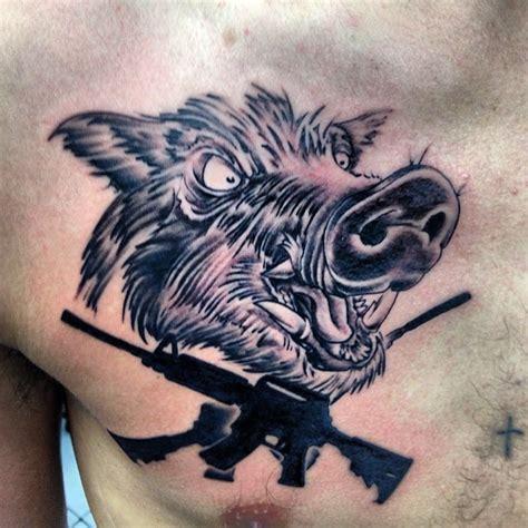 hog hunting tattoo designs boar and guns tattoos on chest