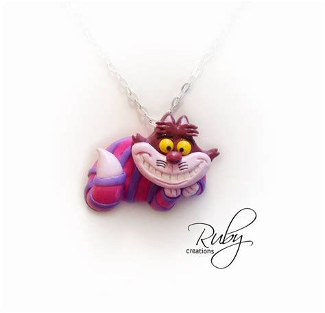 cheshire cat necklace by ruby creations on deviantart