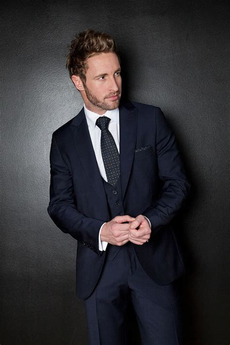 Navy Three Piece Suit With Low Cutist At Slaters
