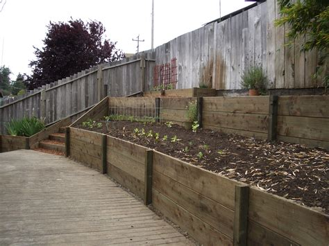 cheap garden wall retaining wall with 2x12 pressure treated wood 2 kyle curtis flickr