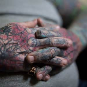 finger tattoo brisbane john s tattoo covered hands with utated finger abc