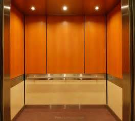 Interior marvelous modern elevator design with wooden design for wall
