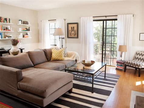 airy neutral living room featuring  shaped couch hgtv