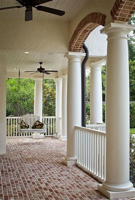 columns for homes love the big porch brick floor not big on the plain