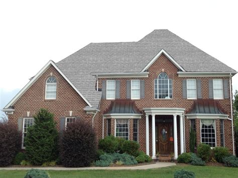 pictures of gray houses with grey metal roof brown